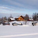 "TML's lodge has a private airstrip on the frozen lake out front, and assorted aircraft regularly buzz in and out. Note the Astar helicopter parked right out front and ready for liftoff. This summer, they added over 12,000 square feet of living space, including a second, private lodge to the operation. ""In a decade of operating we've learned a lot,"" says General Manager Mike Overcast. ""The remodel and renovation of the property and adding more chalets and more lodges became important to me. We want the message to be that these guys are getting better and better at what they do, not just maintaining the status quo."" Photo: Colin Wiseman."