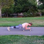 Skateboard Plank (Step 1): Keep your core engaged and push the skateboard forwards and backwards, maintaining good form by not letting your hips drop or your back arch.
