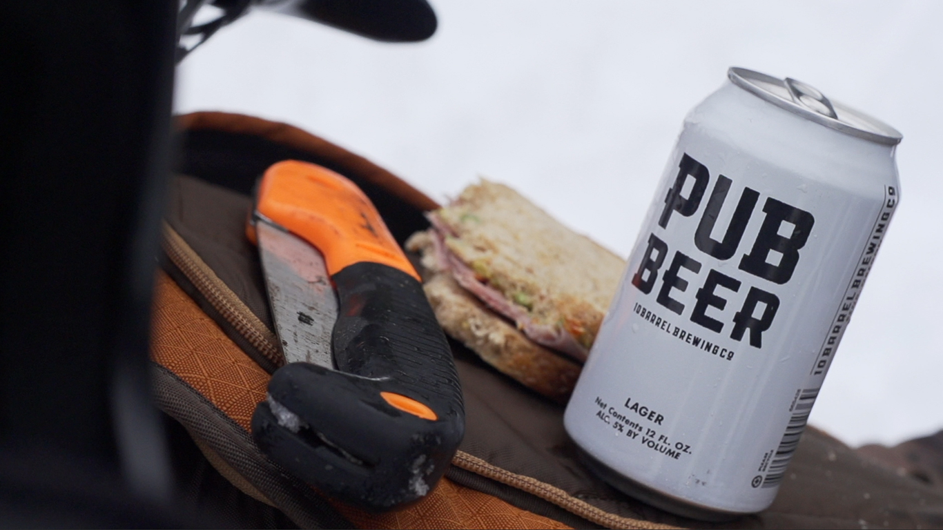 Backcountry essentials: Folding saw. Pub Beer. Ham sammy.