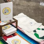 """Copies of Tim and Hannah Eddy's book, """"Split the Difference,"""" and Do Radical t-shirts (100% organic cotton, of course)."""