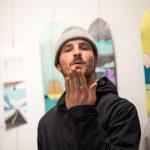 Gnu's Marketing Guru, Dave Marx, blowing a little smoochie in front of Hannah Eddy's art.