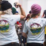 Hana Beaman and Robin Van Gyn showing off the Lay-Back tee. Art by Hannah Eddy. Photo: Erin Hogue.