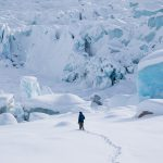 Chris Kassar at the foot of the Triumvirate Glacier.