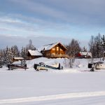 The original lodge doubled in size this past summer, but the aircraft parking remained the same. Four ski planes and a helicopter, at your disposal.