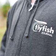 TFFJ zip hoodie logo close up view.