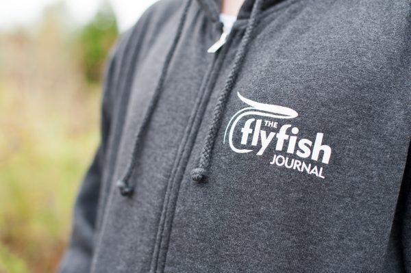 TFFJ zip hoodie logo close up view.