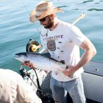 James Castner holds a farm raised Atlantic salmon. Washington State Fish and Wildlife has set up a website where anglers can report their catch. Licensed anglers can keep as many Atlantic salmon as they desire, as long as they are caught within current open marine areas.