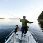 Nathan Weston casts towards jumping Atlantic salmon while his son, Trevor Weston, looks on. Using heavy sinking lines and eight-weight fly rods, the salmon will take flies, but can be tricky to catch.